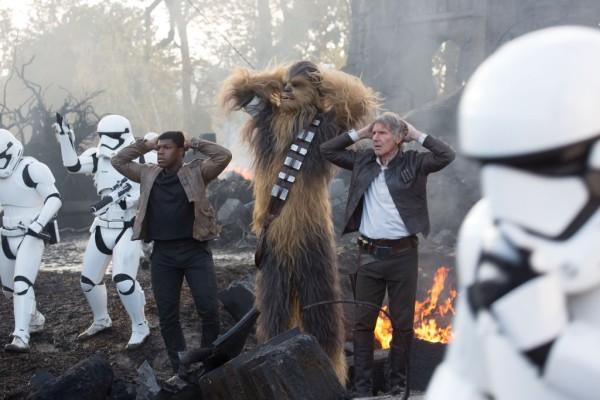Star Wars: The Force Awakens L to R: Finn (John Boyega), Chewbacca (Peter Mayhew), and Han Solo (Harrison Ford) Ph: David James © 2015 Lucasfilm Ltd. & TM. All Right Reserved.